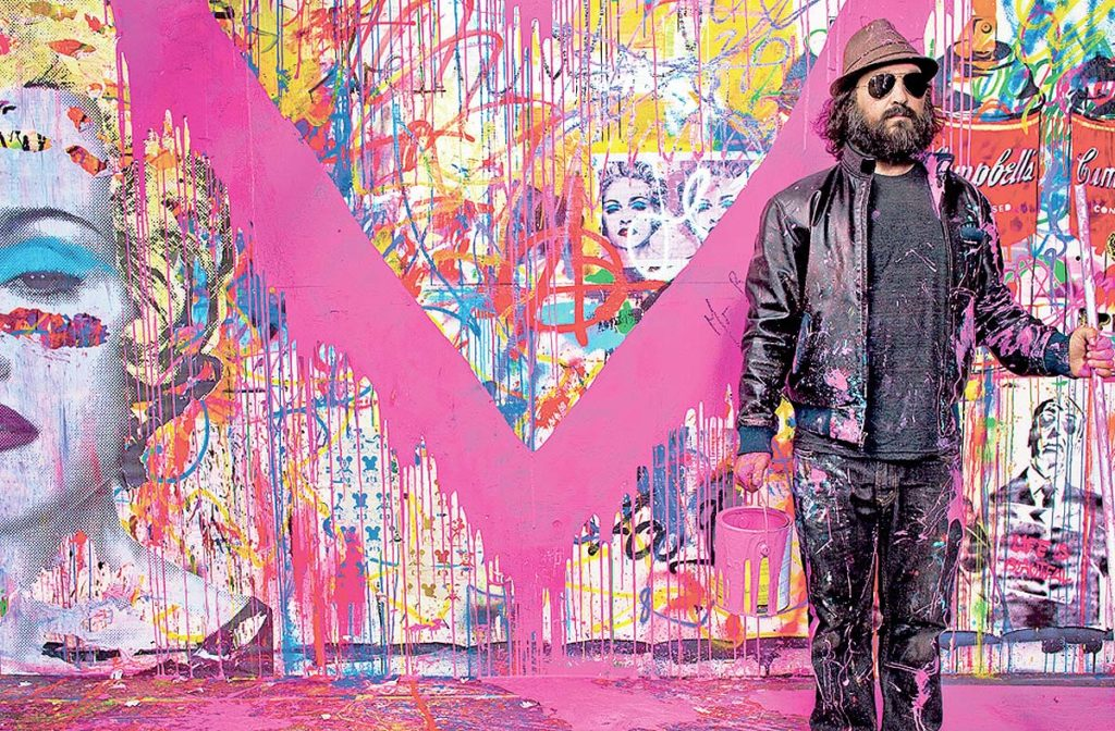 Artist Thierry Guetta with one of his artworks